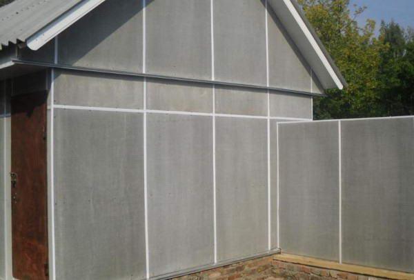 Обшивка фасада и забор из плоского асбестоцемента
