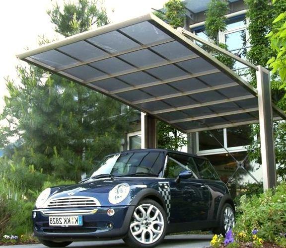 На фото - пример навеса оригинальной формы и конструкции для защиты автомобиля от осадков.
